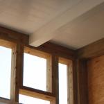Fissaggio travi di piano su pareti in legno