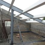 Montaggio telaio in acciaio e travi di copertura in legno lamellare