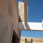 Fissaggio Travi di copertura su fabbricato esistente mediante piastra a progetto