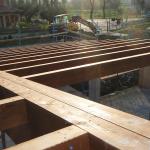 Fissaggio travi secondarie su travi portanti in legno